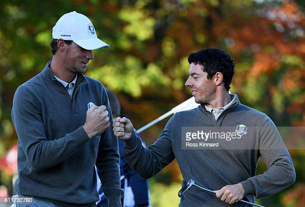 Thomas Pieters and Rory McIlroy of Europe react on the fourth green during morning foursome matches of the 2016 Ryder Cup at Hazeltine National Golf...
