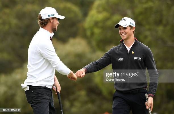 Thomas Pieters and Thomas Detry of Belgium celebrate a birdie during day three of the 2018 World Cup of Golf at The Metropolitan on November 24 2018...