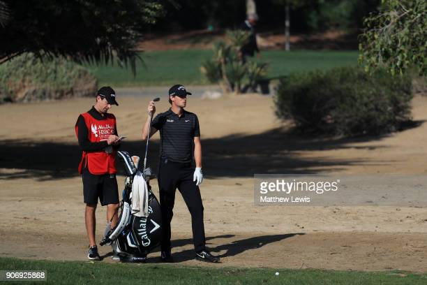 Thomas Pieters of Belgium and caddie Adam Marrow prepare to play the third shot on the 18th hole during round two of the Abu Dhabi HSBC Golf...