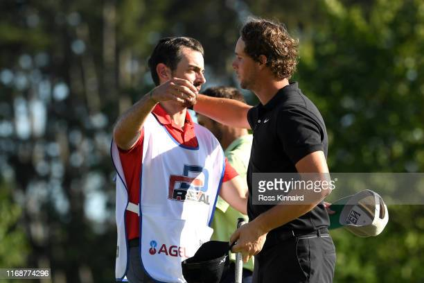 Thomas Pieters of Belgium celebrates victory with his caddie on the 18th green after the final round during Day Four of the D+D Real Czech Masters at...