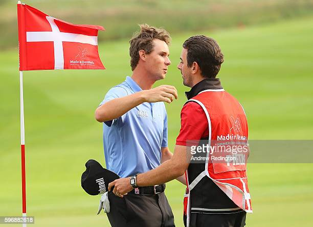 Thomas Pieters of Belgium embraces his caddie Adam Marrow on the 18th green during the final round of Made in Denmark at Himmerland Golf Spa Resort...
