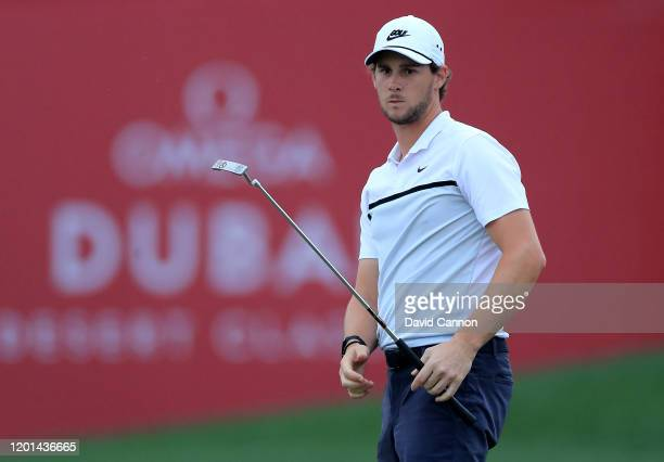 Thomas Pieters of Belgium hits a putt on the ninth hole during the first round of the Omega Dubai Desert Classic on the Majlis Course at The Emirates...