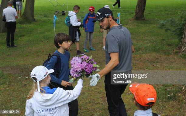 Thomas Pieters of Belgium is given a bunch of flowers by a young fan as he plays in the pro am ahead of the Belgian Knockout at the Rinkven...