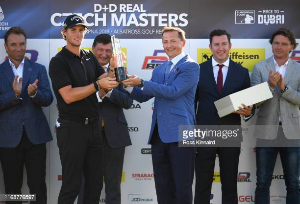 Thomas Pieters of Belgium is presented with his trophy by Petr Dedek after winning the D+D Real Czech Masters during Day Four of the D+D Real Czech...