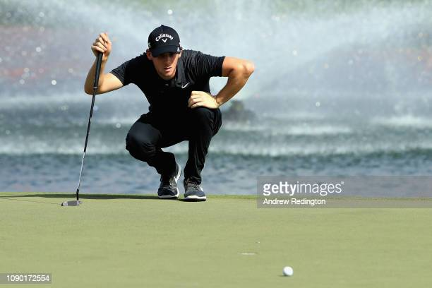 Thomas Pieters of Belgium lines up a putt on hole eighteen during Day Four of the Omega Dubai Desert Classic at Emirates Golf Club on January 27,...