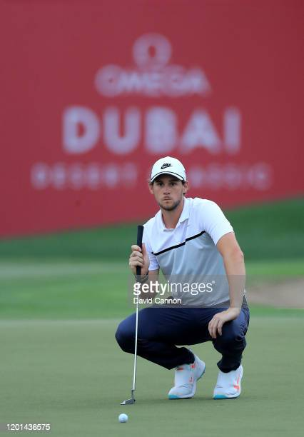 Thomas Pieters of Belgium lines up a putt on the ninth hole during the first round of the Omega Dubai Desert Classic on the Majlis Course at The...