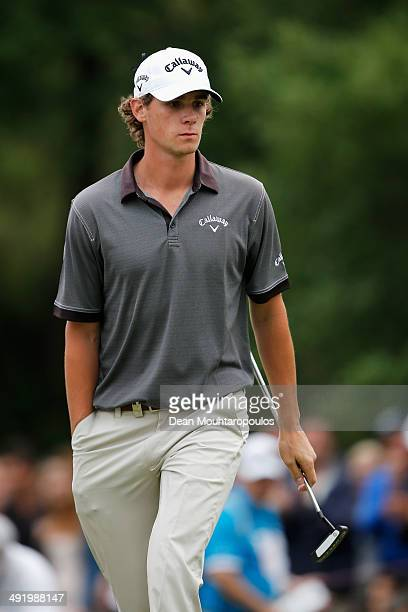 Thomas Pieters of Belgium looks on after putts on the 18th green during the final round of the Open de Espana held at PGA Catalunya Resort on May 18...