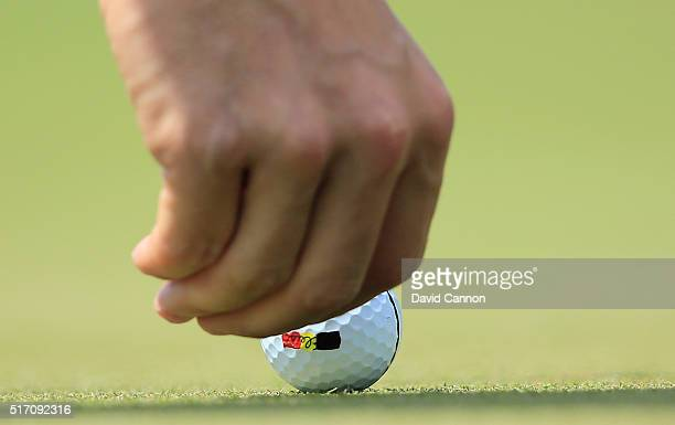 Thomas Pieters of Belgium marks his golf ball on the first green during the first round of the World Golf ChampionshipsDell Match Play at the Austin...