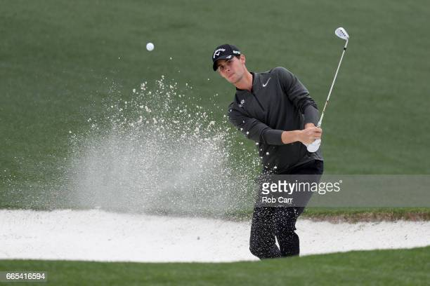 Thomas Pieters of Belgium plays a shot from a bunker on the 18th hole during the first round of the 2017 Masters Tournament at Augusta National Golf...