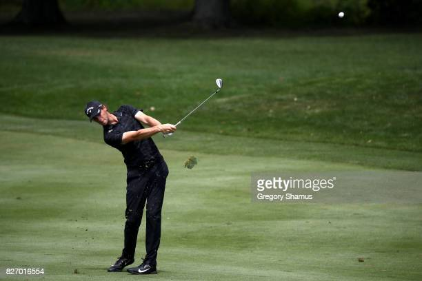 Thomas Pieters of Belgium plays a shot on the first fairway during the final round of the World Golf Championships Bridgestone Invitational at...