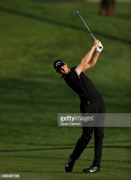 Thomas Pieters of Belgium plays his second shot to the par 5 10th hole during the first round of the 2017 Omega Dubai Desert Classic on the Majlis...