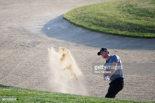 Thomas Pieters of Belgium plays his third shot from a bunker on the 18th hole during round three of the Abu Dhabi HSBC Golf Championship at Abu Dhabi...
