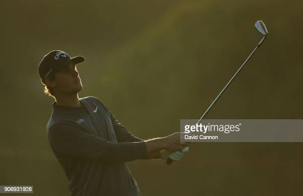 Thomas Pieters of Belgium plays his third shot on the par 5 10th hole during the second round of the 2018 Abu Dhabi HSBC Golf Championship at the Abu...