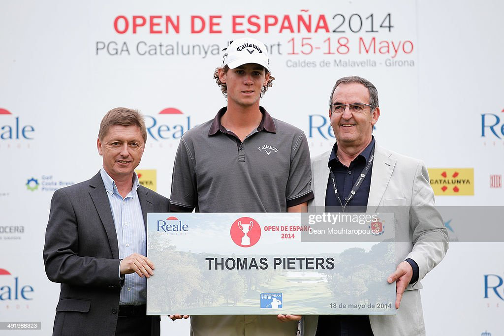 Thomas Pieters (C) of Belgium poses after his second place in the Open de Espana held at PGA Catalunya Resort on May 18, 2014 in Girona, Spain.