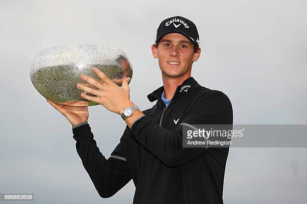 Thomas Pieters of Belgium poses with the trophy following his victory during the final round of Made in Denmark at Himmerland Golf & Spa Resort on...