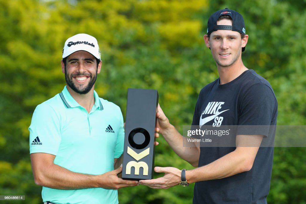 Thomas Pieters of Belgium presents the trophy to Adrian Otaegui of Spain after he beats Benjamin Hebert during their final match to win the tournament on the final day of the Belgian Knockout at Rinkven International Golf Club on May 20, 2018 in Antwerpen, Belgium.