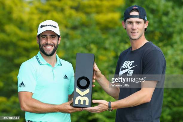 Thomas Pieters of Belgium presents the trophy to Adrian Otaegui of Spain after he beats Benjamin Hebert during their final match to win the...