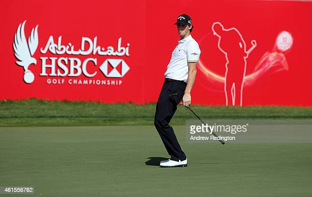 Thomas Pieters of Belgium reacts after missing an eagle putt on the 18th green during the first round of the Abu Dhabi HSBC Golf Championship at the...