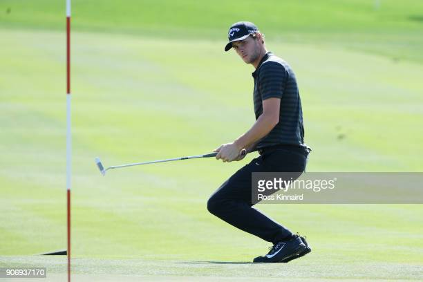 Thomas Pieters of Belgium reacts to his birdie attempt on the eighth green during round two of the Abu Dhabi HSBC Golf Championship at Abu Dhabi Golf...