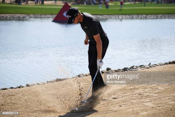 Thomas Pieters of Belgium reacts to his second shot on the ninth hole during round two of the Abu Dhabi HSBC Golf Championship at Abu Dhabi Golf Club...
