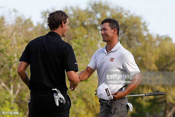 Thomas Pieters of Belgium shakes hands with Adam Scott of Australia after they halved their match on the 18th green during the first round of the...