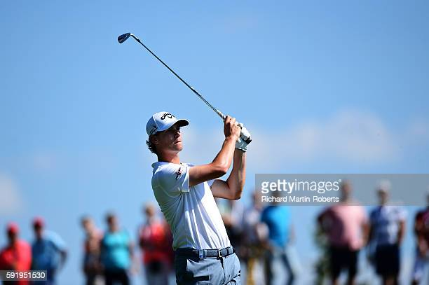 Thomas Pieters of Belgium takes his second shot on the 8th hole during day two of the DD REAL Czech Masters at Albatross Golf Resort on August 19...