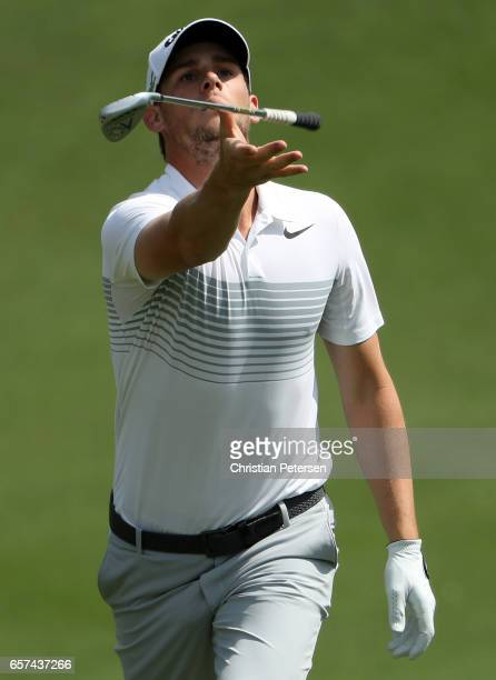 Thomas Pieters of Belgium tosses his club on the 18th hole of his match during round three of the World Golf ChampionshipsDell Technologies Match...