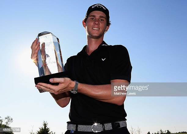 Thomas Pieters of Belguim celebrates with the trophy after winning the D+D Real Czech Masters at the Albatross Golf Resort on August 30, 2015 in...