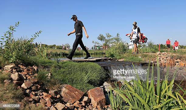 Thomas Pieters of Belguim walks up the 17th hole with his caddie during day four of the DD Real Czech Masters at the Albatross Golf Resort on August...