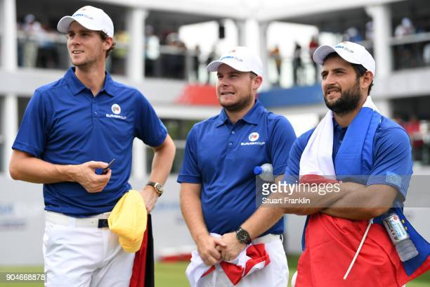 Thomas Pieters Tyrrell Hatton and Alexander Levy of Europe look on during the singles matches on day three of the 2018 EurAsia Cup presented by...