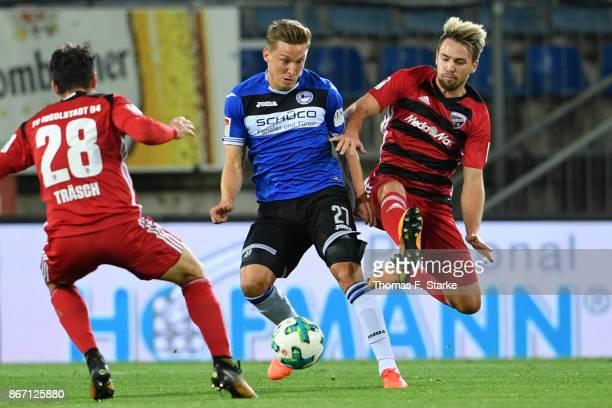 Thomas Pledl of Ingolstadt tackles Konstantin Kerschbaumer of Bielefeld during the Second Bundesliga match between DSC Arminia Bielefeld and FC...