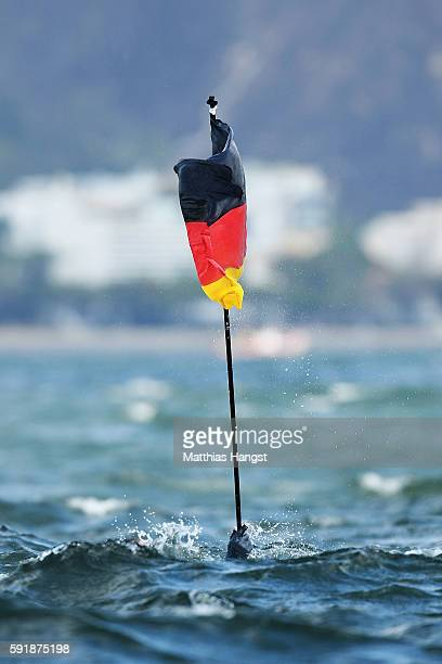 Thomas Ploessel of Germany celebrates by jumping in the sea after winning the bronze medal in the Men's 49er class at the Marina da Gloria on Day 13...