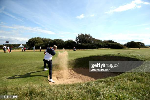 Thomas Plumb of Great Britain and Ireland plays a bunker shot on the sixth in the singles matches during Day 2 of the Walker Cup at Royal Liverpool...
