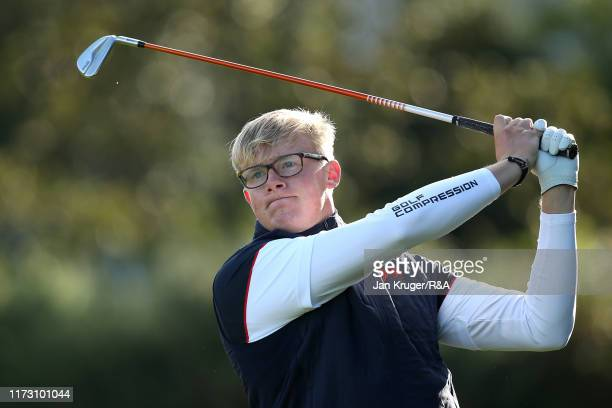 Thomas Plumb of Great Britain and Ireland plays a shot in the foursome matches during Day 2 of the Walker Cup at Royal Liverpool Golf Club on...