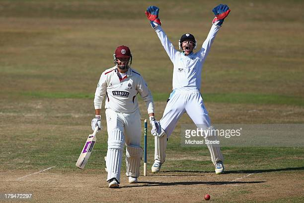 Thomas Poynton the wicketkeeper of Derbyshire successfully appeals for the lbw wicket of Marcus Trescothick of Somerset off the bowling of Wayne...