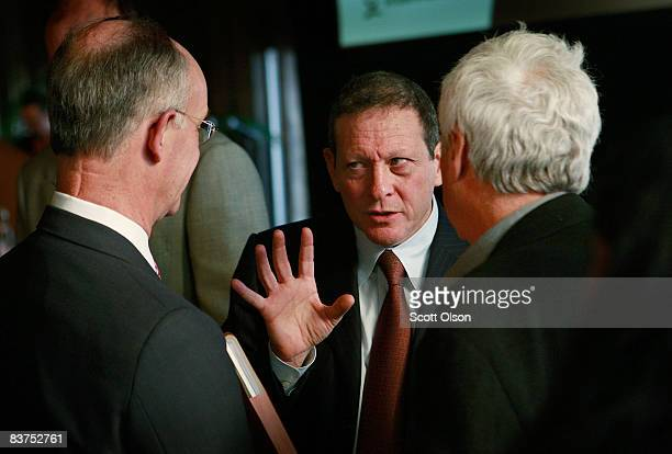 Thomas Pritzker Chairman of Global Hyatt Corporation speaks with guests following a panel discussion on the global financial crisis hosted by The...
