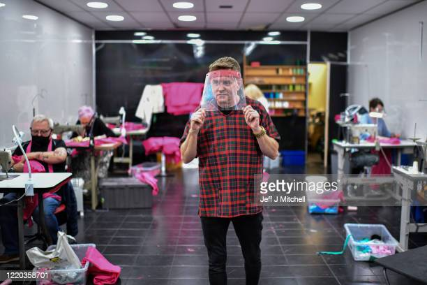 Thomas Rae a tailor and volunteers work at his shop at Easterhouse shopping centre making free scrubs for NHS nurses and doctors on April 22 2020 in...
