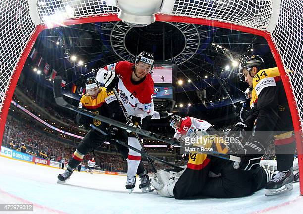 Thomas Raffl of Austria fails to score over Dennis Endrasgoaltender of Germany during the IIHF World Championship group A match between Germany and...