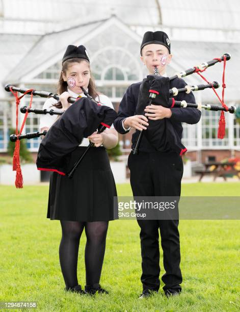 Thomas Rankine and Kaylee Clugston from Govan Schools Pipe Bank sampling some of the Kids Zone activity available at the World Pipe Band...