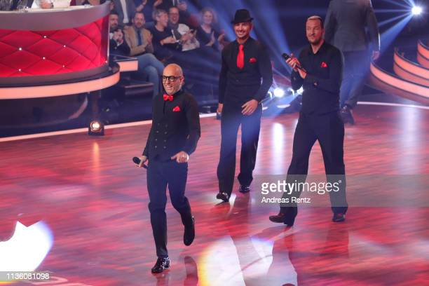 Thomas Rath Benjamin Piwko and Pascal Hens gesture perform on stage during the preshow 'Wer tanzt mit wem Die grosse Kennenlernshow' of the...