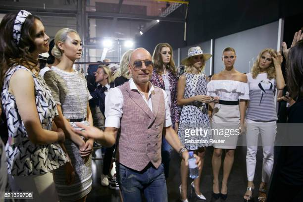 Thomas Rath talks to models backstage ahead of the Thomas Rath show during Platform Fashion July 2017 at Areal Boehler on July 23 2017 in Duesseldorf...