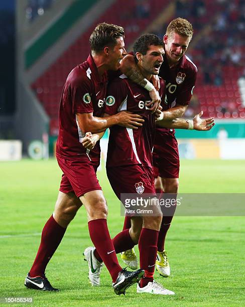 Thomas Rathgeber of Offenbach celebrates his team's first goal with team mates Andre Hahn and Nicolas Feldhahn during the first round match of the...