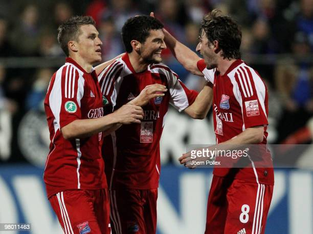 Thomas Rathgeber of Unterhaching celebrates with his team mates after scoring his team's first goal during the 3 Liga match between Holstein Kiel v...