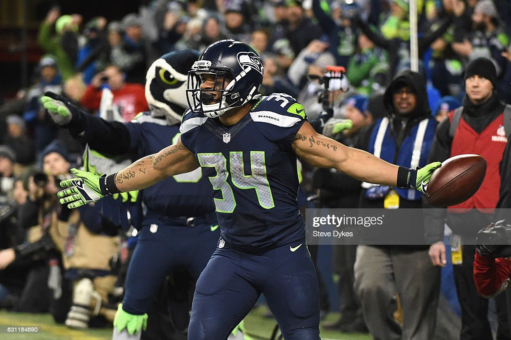 Thomas Rawls #34 of the Seattle Seahawks celebrates scoring a 4-yard touchdown during the fourth quarter against the Detroit Lions in the NFC Wild Card game at CenturyLink Field on January 7, 2017 in Seattle, Washington.