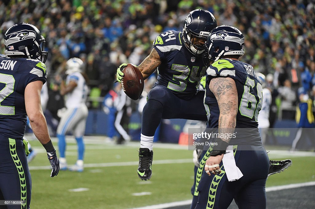 Thomas Rawls #34 of the Seattle Seahawks celebrates with Justin Britt #68 after scoring a 4-yard touchdown during the fourth quarter against the Detroit Lions in the NFC Wild Card game at CenturyLink Field on January 7, 2017 in Seattle, Washington.
