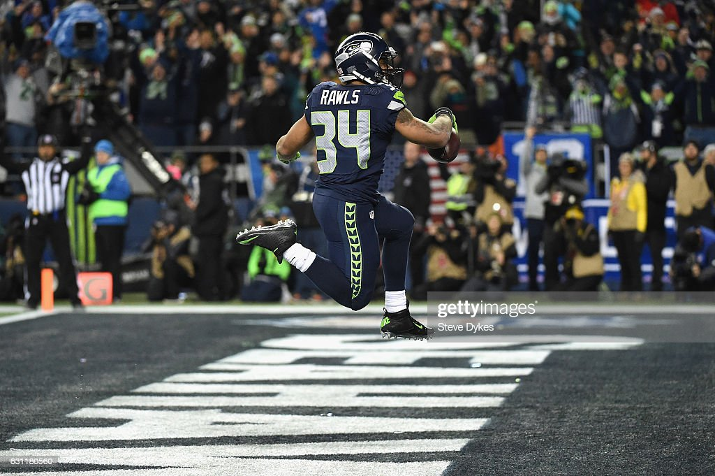 Thomas Rawls #34 of the Seattle Seahawks scores a 4-yard touchdown during the fourth quarter against the Detroit Lions in the NFC Wild Card game at CenturyLink Field on January 7, 2017 in Seattle, Washington.