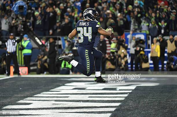 Thomas Rawls of the Seattle Seahawks scores a 4yard touchdown during the fourth quarter against the Detroit Lions in the NFC Wild Card game at...