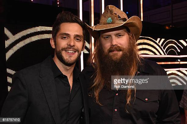 Thomas Rhett and Chris Stapleton take photos backstage during CMT Artists of the Year 2016 on October 19 2016 in Nashville Tennessee
