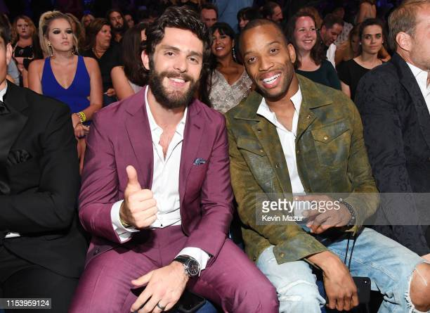 Thomas Rhett and Trombone Shorty attend the 2019 CMT Music Awards Backstage Audience at Bridgestone Arena on June 05 2019 in Nashville Tennessee