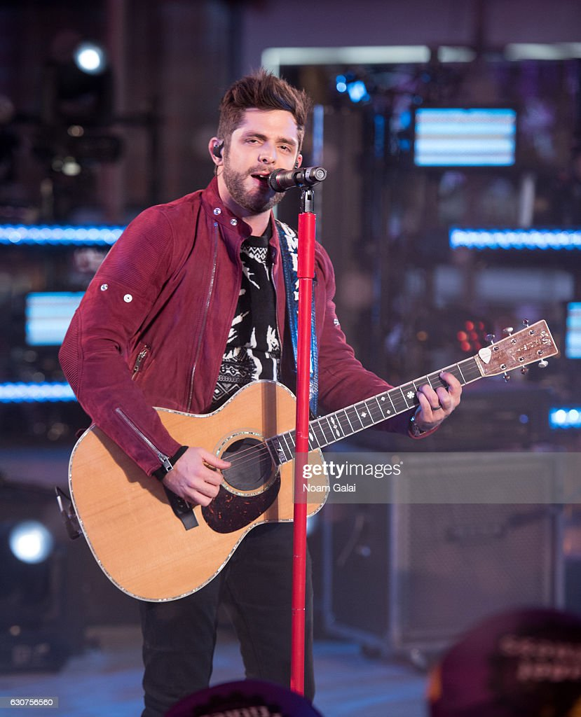 Thomas Rhett performs during New Year's Eve 2017 in Times Square on December 31, 2016 in New York City.